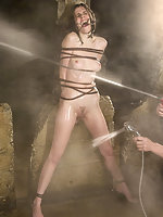 Hard bondage and water torture on a sexy young brunette